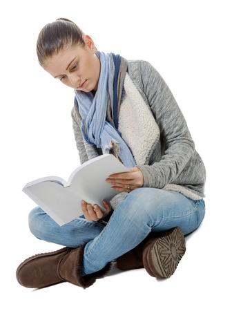 crosslegged: a beautiful girl sitting cross-legged, reading a book on a white background