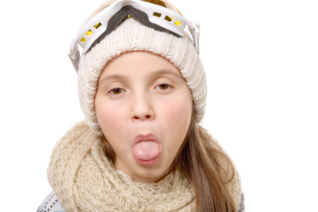 showing: a teenage girl sticking her tongue out isolated on white