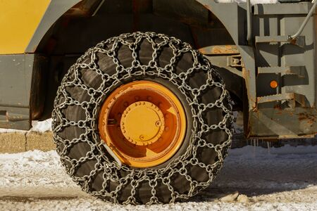 road tractor: the tractor tires with chains in the snow