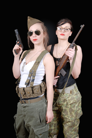 ww2: two sexy women posing in WW2 military uniform and weapons Stock Photo