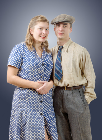 40s: young worker couples in vintage clothing, 40s Stock Photo
