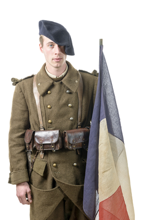 tri  color: a 1940 french soldier with a flag isolated on a white background
