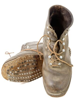 ww2: a pair of old WW2 boots military isolated on white background Stock Photo