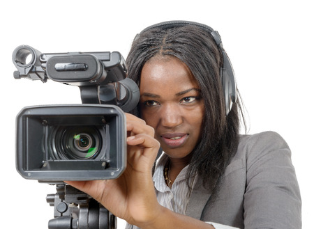 a young African American women with professional video camera and headphone
