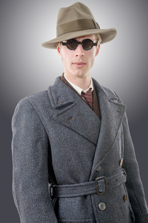 hoodlum: a gangster or FBI agent with a hat and black glasses Stock Photo