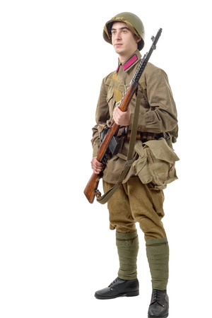 soviet: a young Soviet soldier with  rifle on the white background