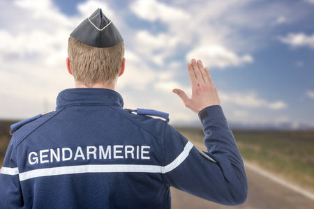 a French policeman on the roadside