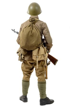 a young Soviet soldier with rifle, back view, on the white background