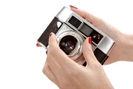 analog camera: a classic old analog camera on white Stock Photo