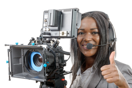 american media: a young African American women with professional video camera and headphone