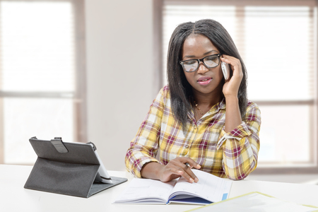 african business: an african american business woman  on phone Stock Photo