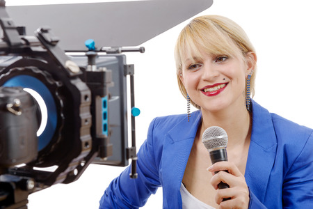 tv reporter: a portrait of elegant woman TV reporter , who is smiling and looking straight at the camera Stock Photo