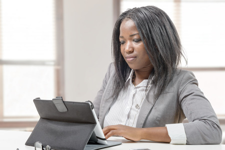 african business: an African american business woman working with tablet Stock Photo