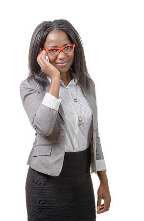 african american woman: an african american business woman with red glasses, on phone