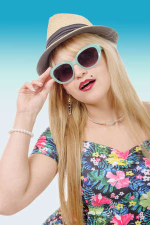 blue hair: a beautiful young pretty blonde woman in sunglasses and  summer hat