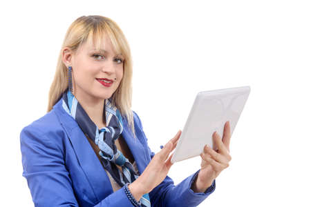 well dressed girl: a beautiful modern businesswoman with blue suit, holding tablet computer