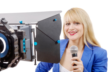 tv reporter: a portrait of elegant woman TV reporter , who is smiling Stock Photo