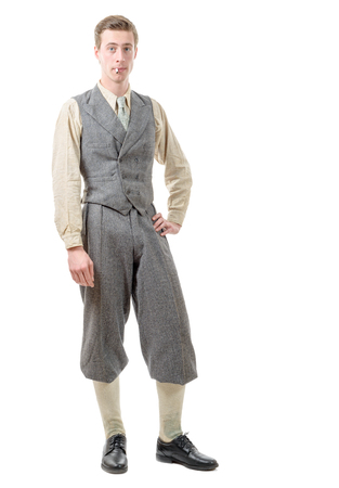 20s: a young man with clothes  in 20s style. on white Stock Photo