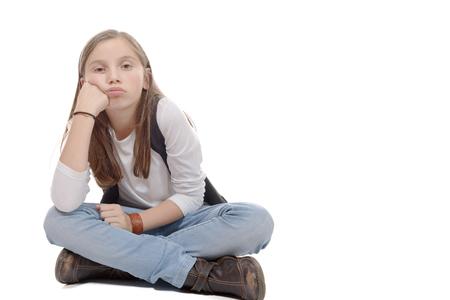 crosslegged: a pretty little girl sitting cross-legged. Isolated on white background Stock Photo