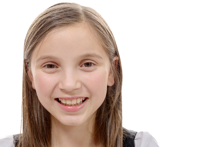 pre adolescents: A portrait of preteen girl isolated on a white background Stock Photo