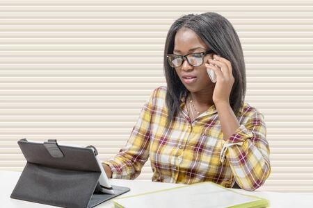 african business: an african american business woman smiling on phone
