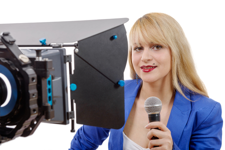 newscast: a portrait of elegant woman TV reporter , who is smiling and looking straight at the camera Stock Photo