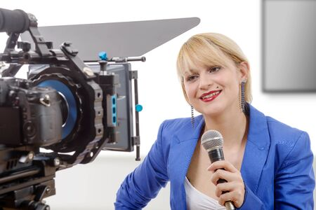 tv reporter: a portrait of elegant blonde woman TV reporter, who is smiling and looking at the camera Stock Photo