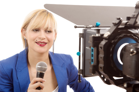 tv reporter: a portrait of elegant blonde woman TV reporter, who is smiling