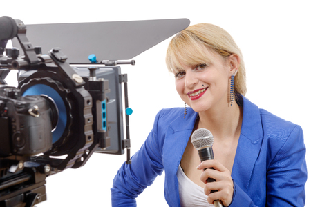 tv reporter: a portrait of elegant blonde woman in blue suit, TV reporter, who is smiling