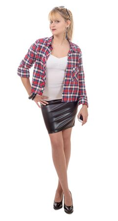 clothed: beautiful young woman clothed in a leather skirt and shirt, on white