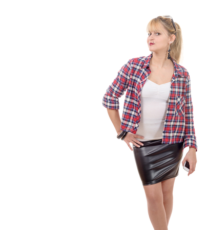 beautiful young woman clothed in a leather skirt and shirt, on white
