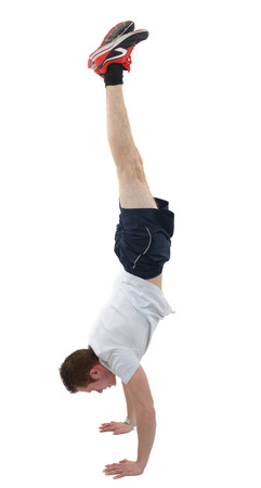joga: man doing the handstand isolated over a white background Stock Photo