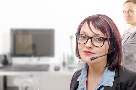 handsfree phones: a close-up portrait of smiling young woman with headset Stock Photo
