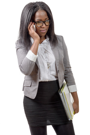 african business: african american business woman smiling on phone Stock Photo