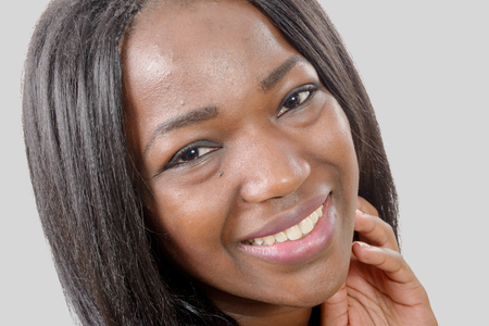 african american woman: a portrait of beautiful African American  young woman smiling