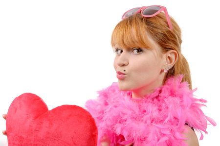 female sexuality: a young beautiful woman with big red heart pillow Stock Photo