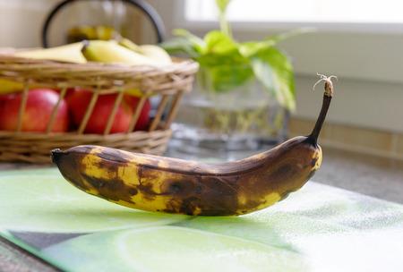 bad banana: a rotten banana on the table Stock Photo