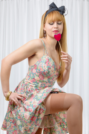 sexy lollipop: a sexy pin up girl with lollipop candy
