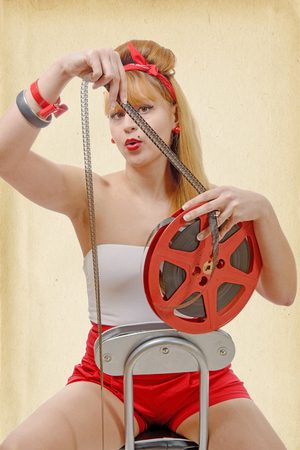 16mm: a sexy pin-up girl with a film reel