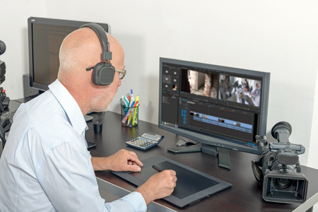 a video editor in his studio