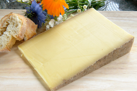 mount tom: a french cheese Comte on a wooden tray Stock Photo