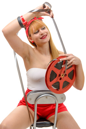 16mm: a sexy pin-up girl with a film reel, on white Stock Photo