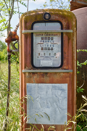 abandoned gas station: old abandoned gas pump in a meadow Stock Photo