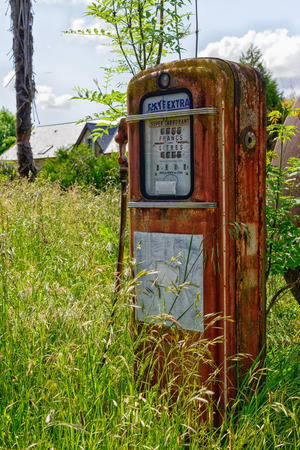 old abandoned gas pump in a meadow Stock Photo