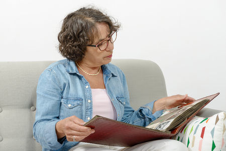 photo album: a middle-aged woman looking at photo album