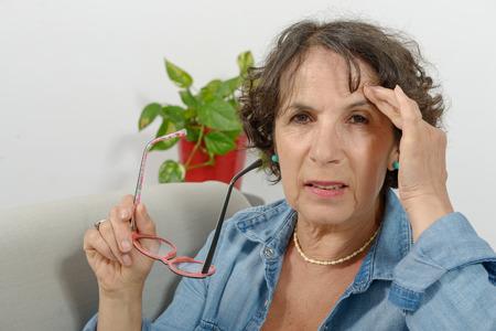 a middle-aged woman has headache