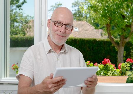 websurfing: a mature man at home websurfing on internet