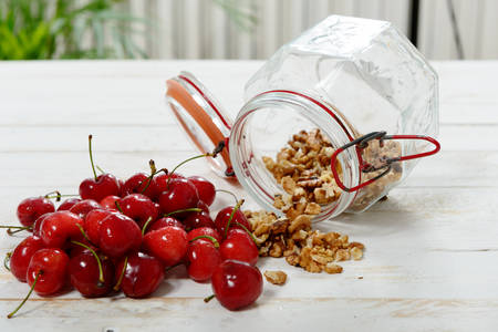 hulled: a glass jar with hulled nuts and cherries