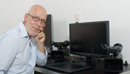 businessman working at his computer: a mature man working with his computer Stock Photo