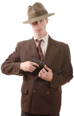 gangster background: a gangster in a suit vintage, with handgun on white background